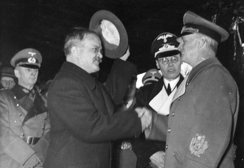 Molotov-Ribbentrop Pact (pictured: The two foreign ministers greet each other at Anhalter Bahnhof in Berlin)
