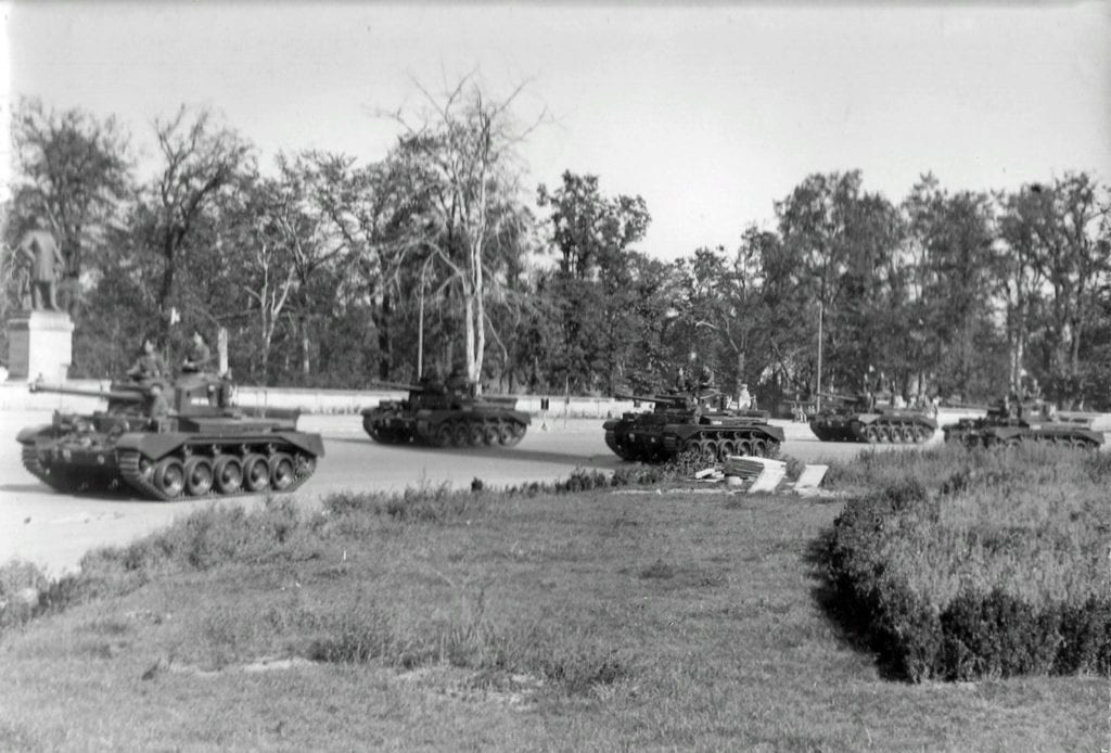 24 British medium cruiser tanks A-34 Comet from the 7th British Panzer Division passing through the Großer Stern in Berlin's Tiergarten park.