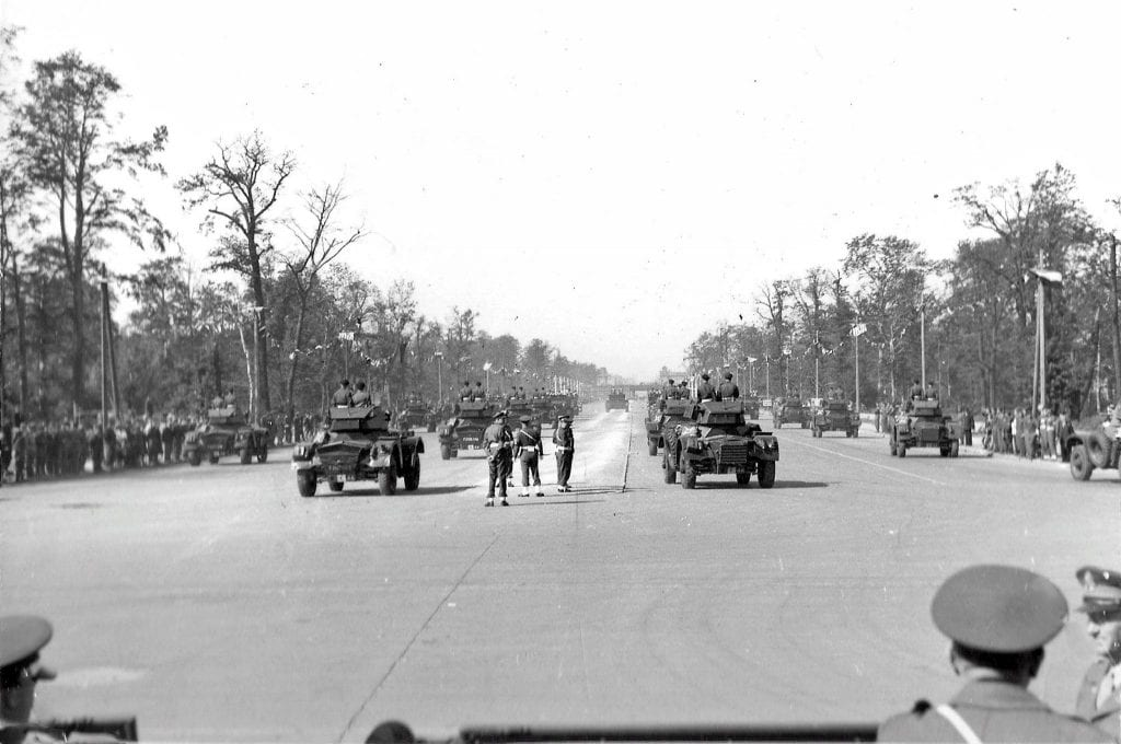 The convoy of 30 British light reconnaissance armored vehicles Daimler Mk II from the 7th British Panzer Division passes through the Charlottenburger Chaussee