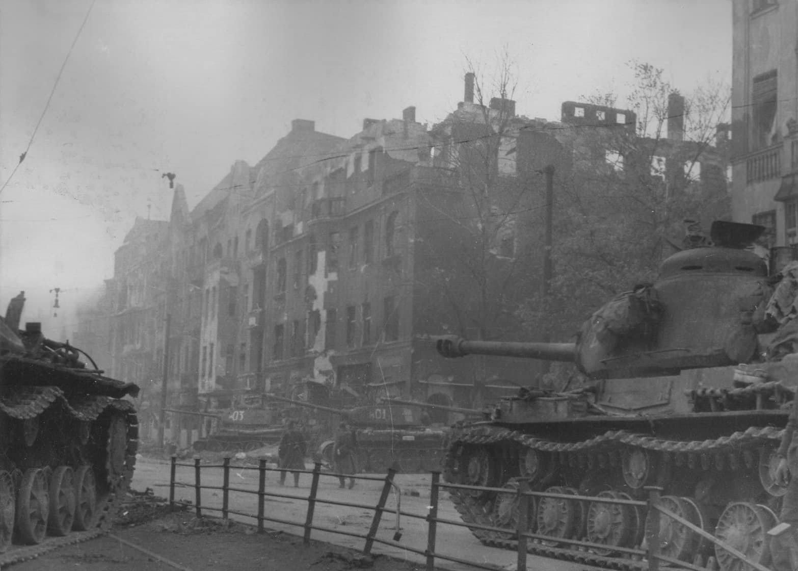 Column of the division of the Soviet heavy tanks IS-2 on the streets of Berlin