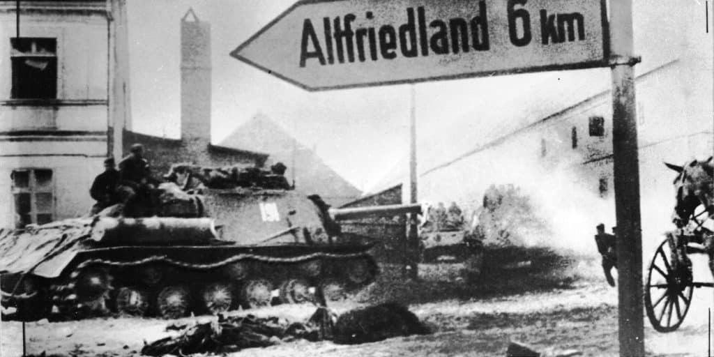 Soviet self-propelled gun ISU-122 moves along the street of the village in Brandenburg