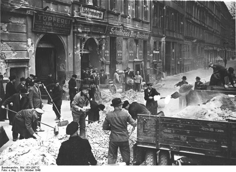 Berliners clearing the streets of rubble following an Allied air attack