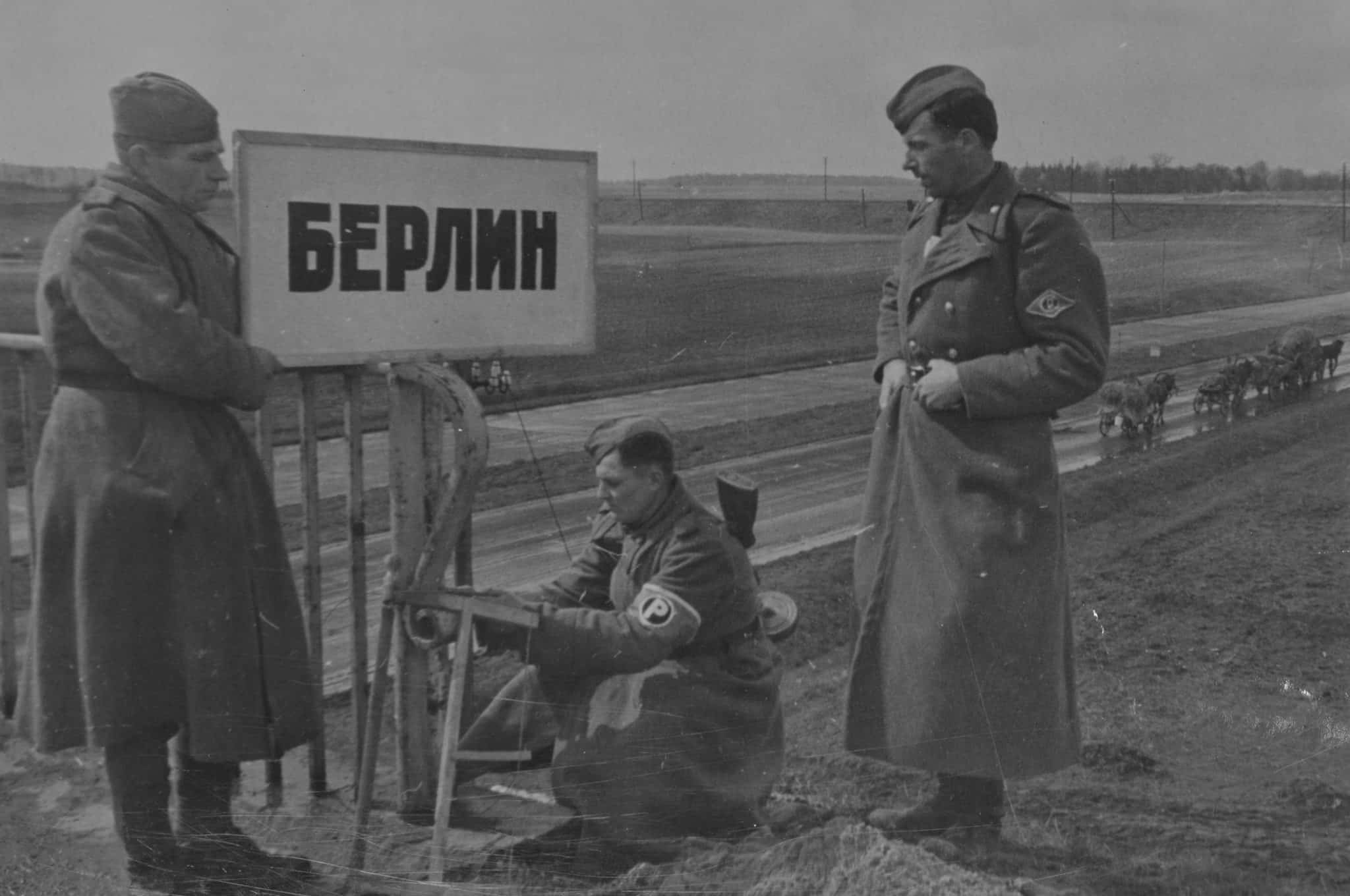 Soviet traffic controllers set a sign in front of the bridge at the entrance to Berlin