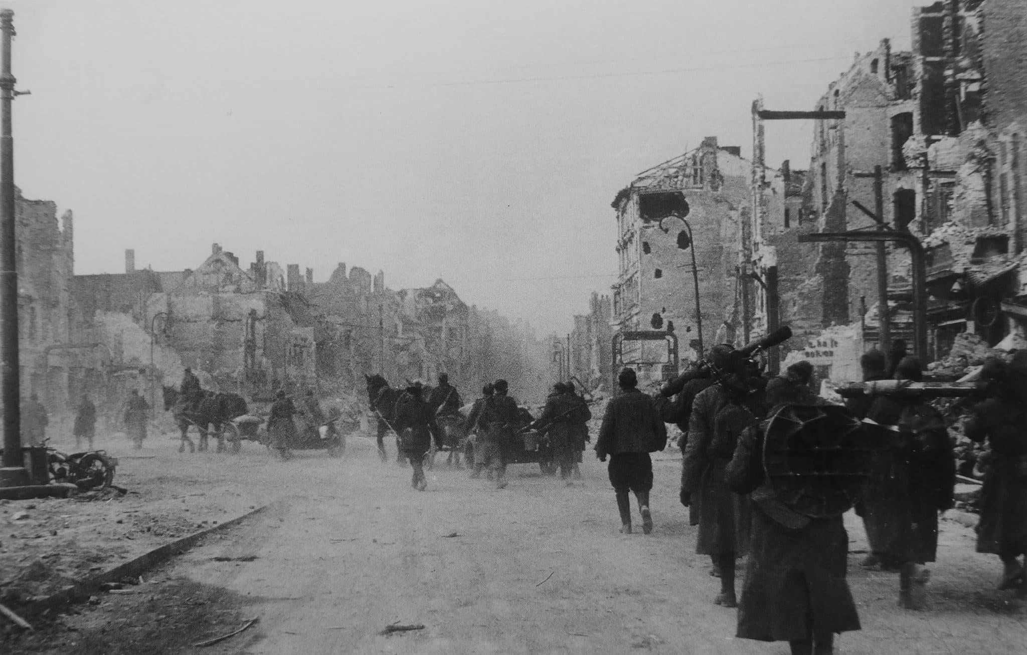 A column of Soviet artillerymen on the march along the Frankfurter Allee in Berlin