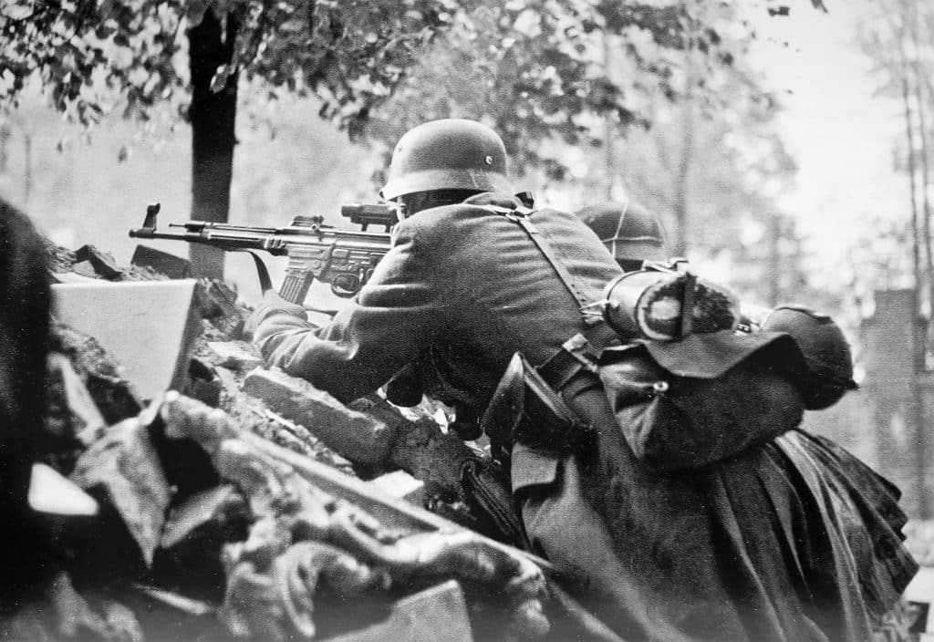 German soldiers in a defensive position on Kolonnenstrasse in Berlin. The foreground is armed with an StG 44 assault rifle with a ZF-4 scope.