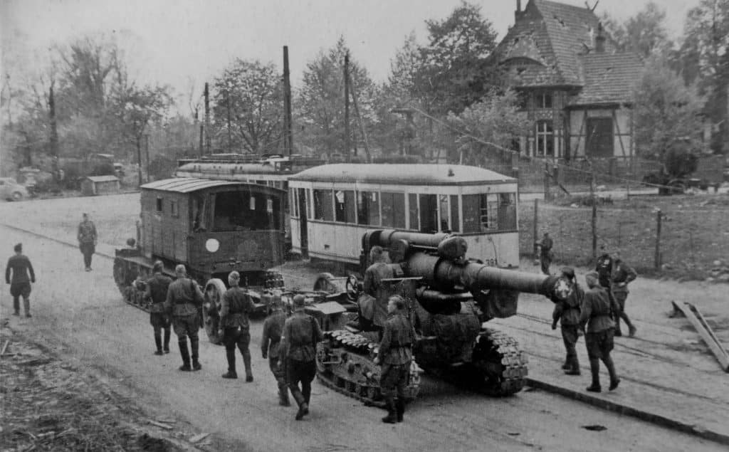 The Soviet artillery tractor Voroshilovets tows a 203-mm howitzer B-4 on the outskirts of Berlin