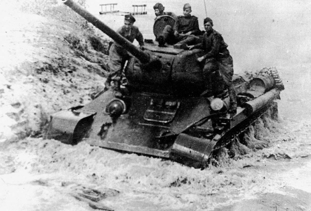 A T-34-85 emerges from the west bank of the Spree river on 17 April. Konev's Fourth Guards Tank Army