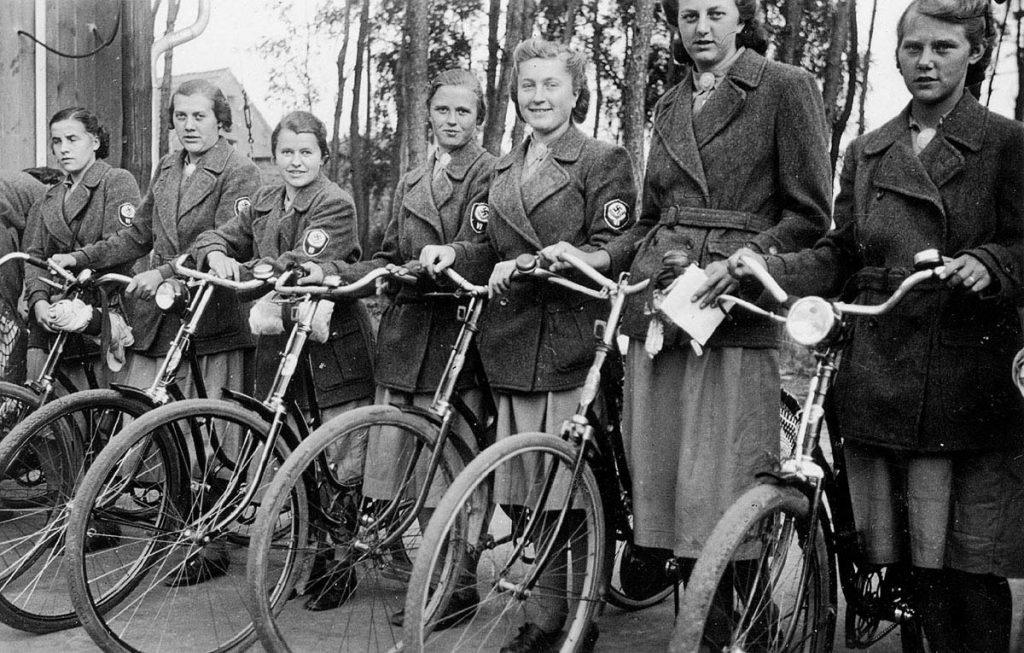 a section of the National Labour Service's female branch (RADwJ) prepare to mount their bicycles and support their male defenders by delivering messages or other tasks