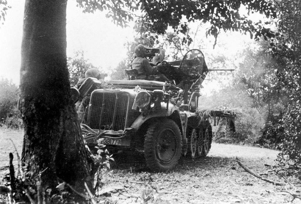 A light anti-aircraft gun fires on Soviet troops as they advance towards Ninth Army's positions in the Spree forests.