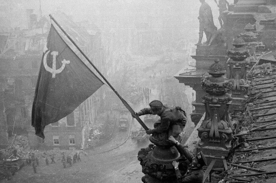 Soviet flag of the Red Army raised above the Reichstag building on May 2nd 1945