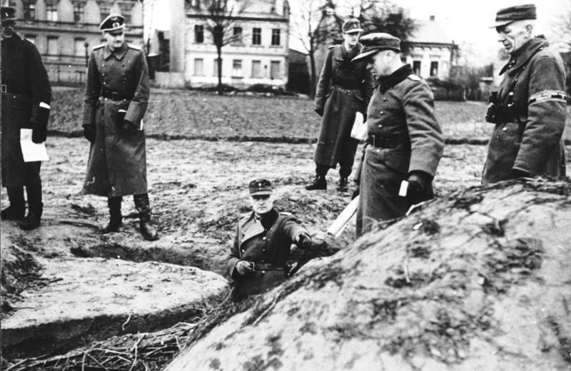 Generalleutnant Hellmuth Reymann inspecting a defensive position with soldiers and Volkssturm men