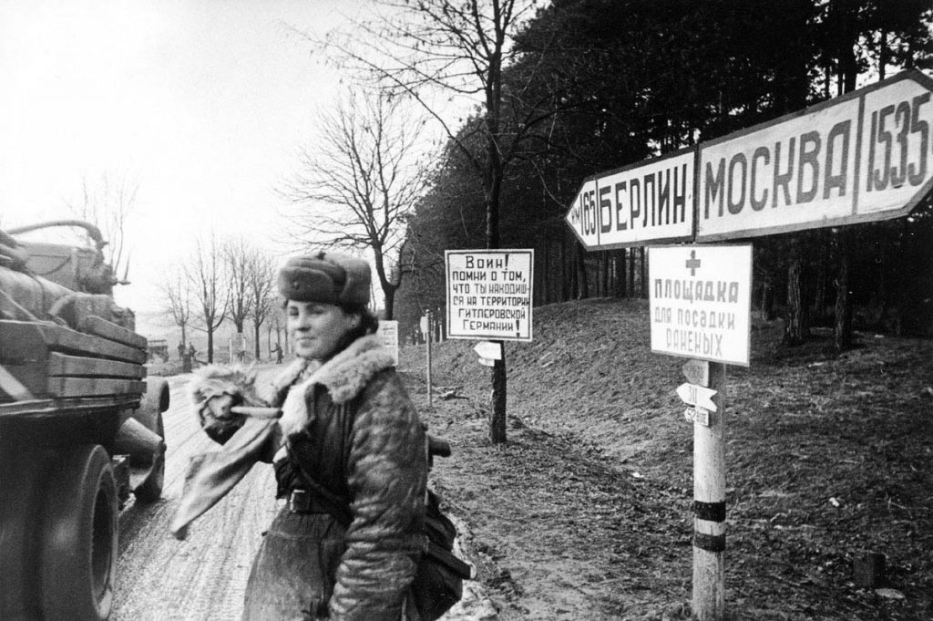 A Soviet soldier directing traffic 165km from Berlin