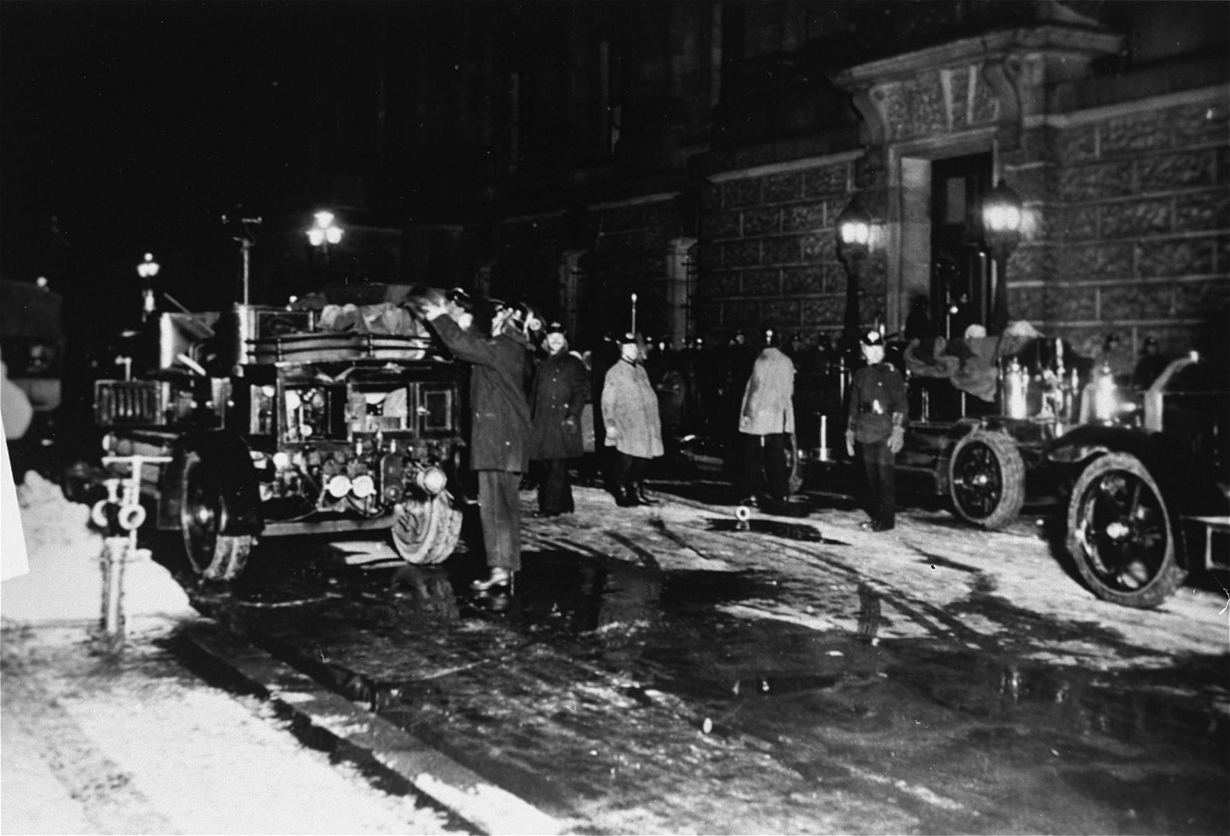 Firefighters arrive at the German parliament during the Reichstag fire, February 27th 1933