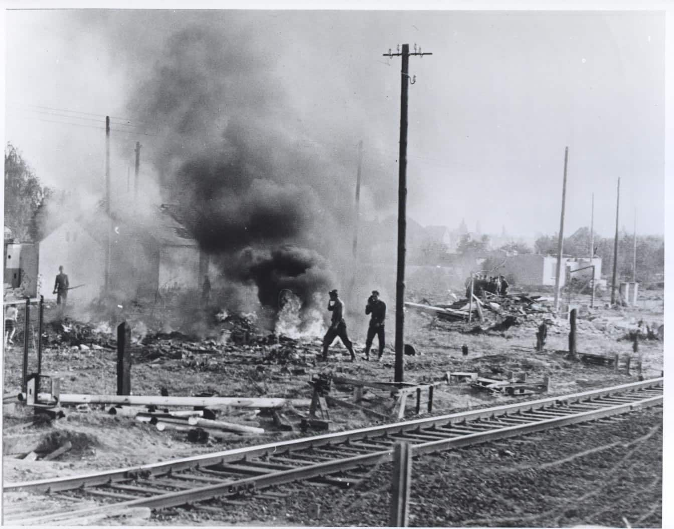 """East Germans continue to clear the land flanking the eastern side of the border, burning what's left of the houses that were razed to provide a clear line of fire at anyone seeking to cross into West Berlin. October 1961. From the CIA booklet """"A City Torn Apart: Building of the Berlin Wall."""""""