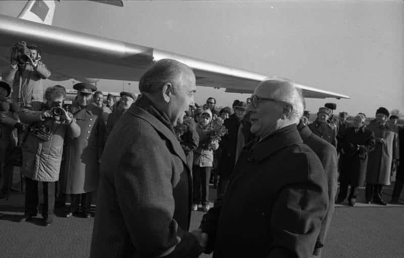 Soviet leader Mikhail Gorbachev greeting East German leader and 'architect of the Berlin Wall' Erich Honecker