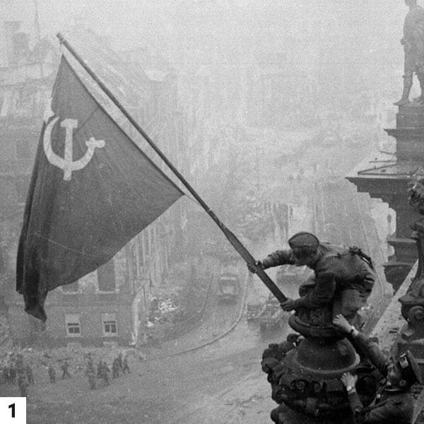 Soviet Soldiers Raising A Flag At The Reichstag