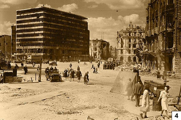 Potsdamer Platz, Berlin, 1945. On the left the Columbushaus, on the right the ruin of Hotel Fürstenhof. Canadian soldiers in the jeep/Public Domain