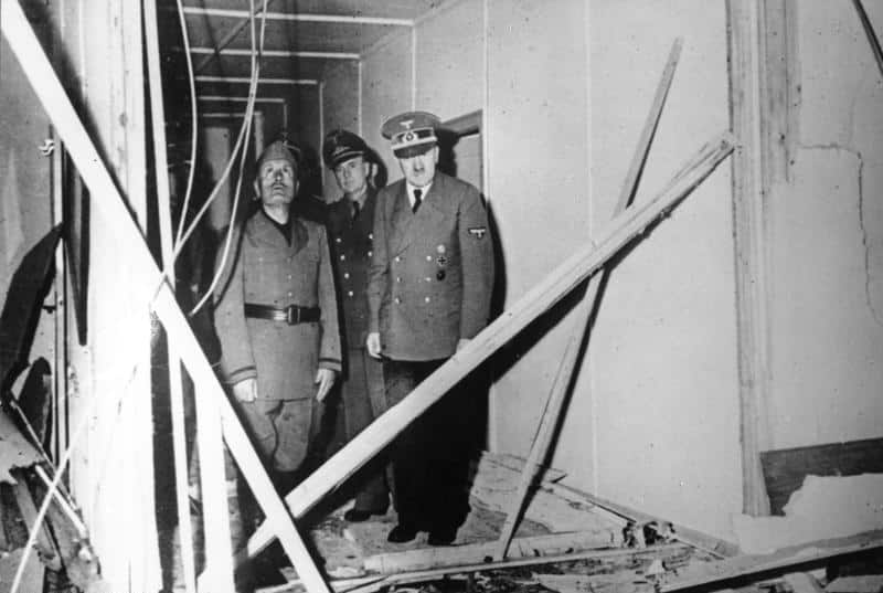 Adolf Hitler with Italian Fascist leader, Benito Mussolini, at the Wolf's Lair headquarters - inspecting damage following an assassination attempt
