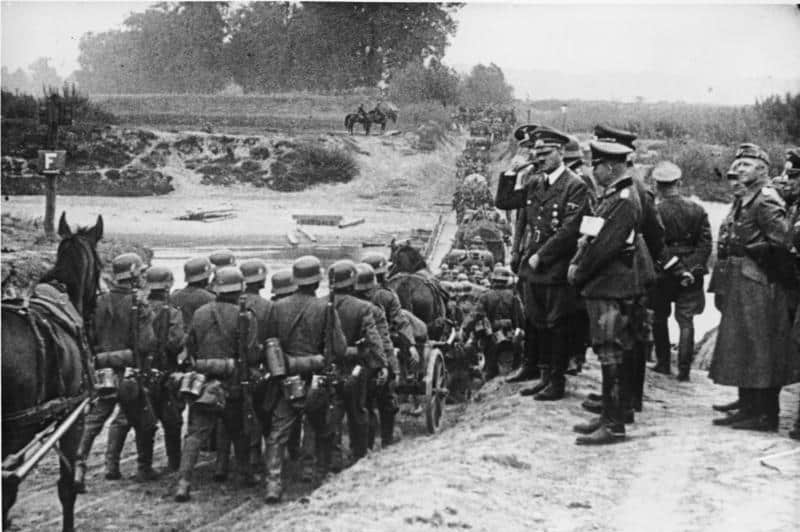 """German soldiers march into Poland in September 1939 - as depicted in the Nazi movie """"Feldzug in Polen"""""""
