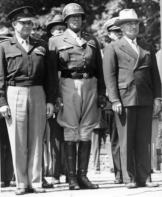 The Potsdam Conference - July 20th 1945 - General Dwight Eisenhower, General George Patton, and President Harry S. Truman. The Flag of Liberation is being raised over the former Nazi headquarters in Berlin.