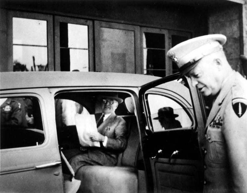 The Potsdam Conference - July 25th 1945 - Truman reading a newspaper with Eisenhower at the door of his car