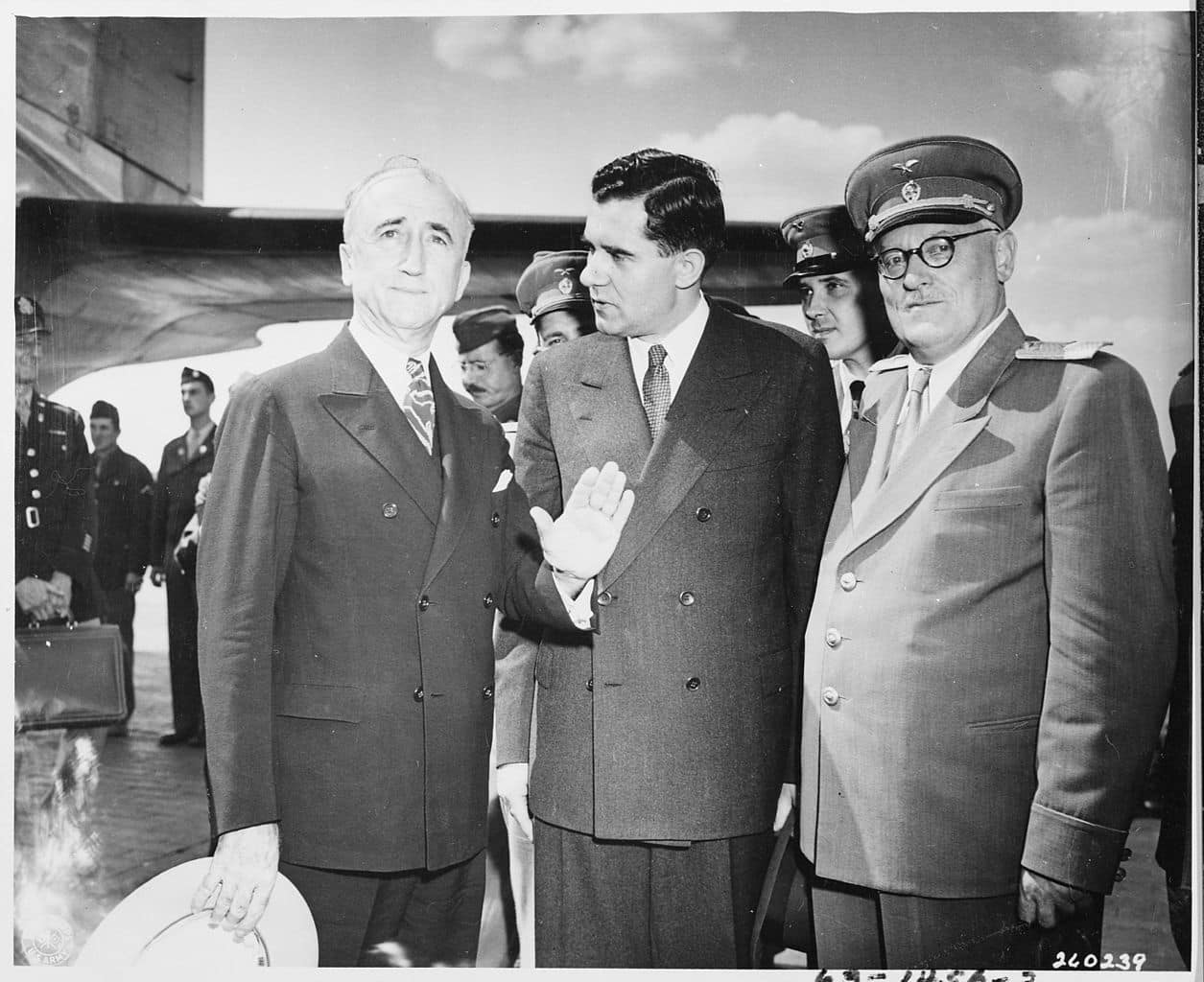 The Potsdam Conference - July 27th 1945 - Secretary of State James Byrnes (left) - seen here greeting Soviet Ambassador to the United States, Andrei Gromyko (center) - would be an essential part of Truman's negotiating team//Image: US National Archives and Records