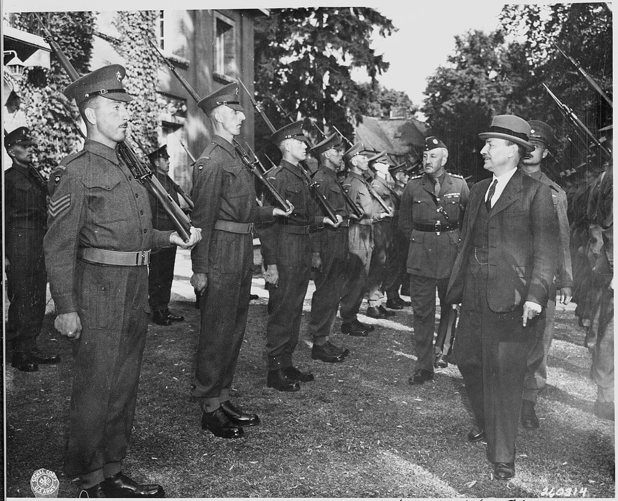 The Potsdam Conference - July 28th 1945 - UK Prime Minister Clement Attlee inspects the honour guards consisting of Scots Guards on the lawn of his villa