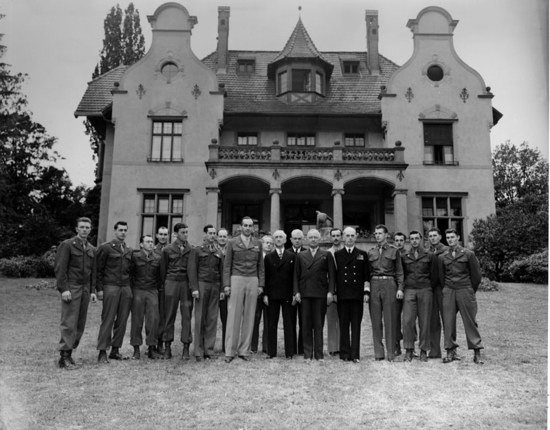 The Potsdam Conference - August 2nd 1945 - President Harry S. Truman (eighth from the right) and members of his party with the staff of the Little White House on the south lawn